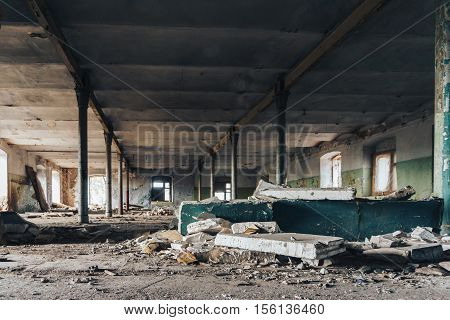 Industrial building interior of abandoned warehouse in dark colors