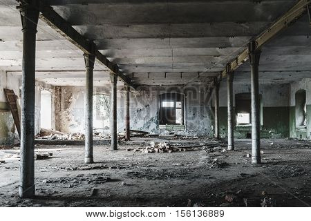 Dramatic view of Industrial building interior of abandoned warehouse in dark colors