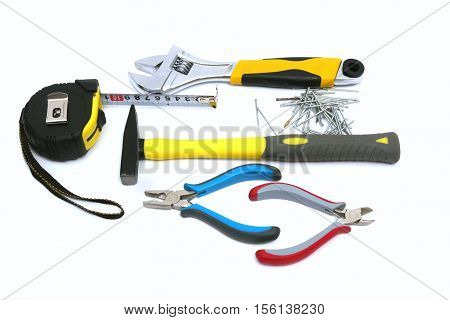 Construction tools and instruments - hammer nail pliers and tape measure. Isolated on white background