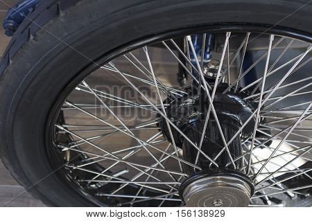 Vintage automobile wheel, rubber tire and spokes