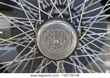 1920's vintage car wheel with spokes and axle