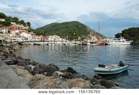 Parga GREECE May 09 2013: Landscape with boat in bay of Parga town on the coast of Ionian sea Greece.