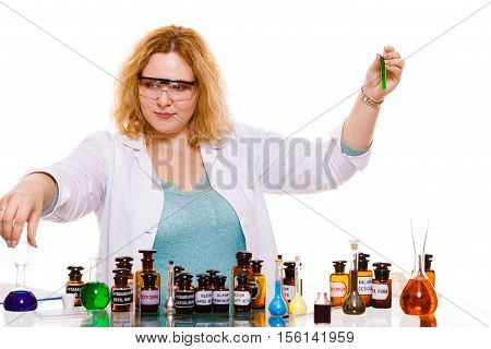 Experiment research in progress. Chemist woman or student girl laboratory assistant or scientific researcher with chemical glassware test flask. Isolated on white