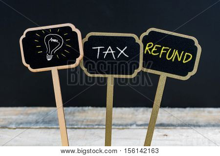 Concept Message Tax Refund And Light Bulb As Symbol For Idea