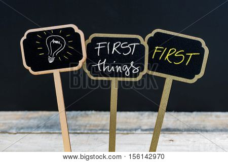 Concept Message First Things First And Light Bulb As Symbol For Idea