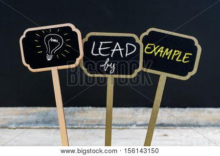 Concept Message Lead By Example And Light Bulb As Symbol For Idea