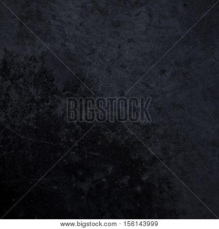 Rough textured black grunge dark concrete photo background