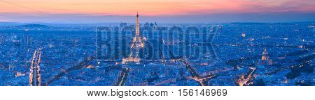 PARIS - JUNE 26: Eiffel Tower brightly illuminated at dusk on JUNE 26 2014 in Paris. The Eiffel tower is the most visited monument of France.