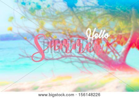 Hello summer text on blurred sea ocean beach background