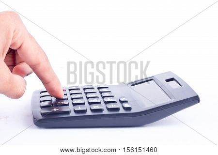 finger hand put button calculator for calculating the numbers accounting accountancy business   on white background  isolated ( side view )