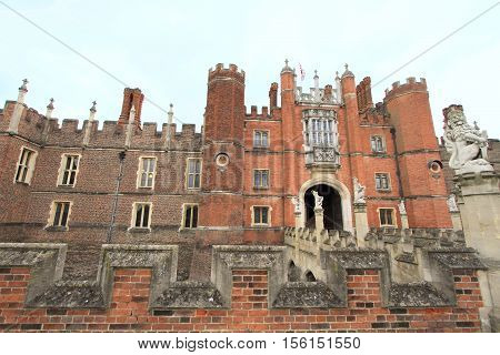 LONDON, ENGLAND - JUNE 14, 2014: Hampton Court Palace on June 14, 2014 in London, England. It is one of the most visited palaces in England.