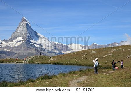ZERMATT, SWITZERLAND- SEPT 1, 2013: Matterhorn mountain and lake on Sept 1, 2013 in Zermatt , Switzerland. It is one of the most popular mountain resorts in Switzerland.