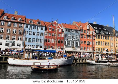 COPENHAGEN, DENMARK - JUNE 5, 2010: View of Nyhavn on June 5, 2010 in Copenhagen, Denmark. It is a landmark medieval port and the most popular bar district in Denmark.
