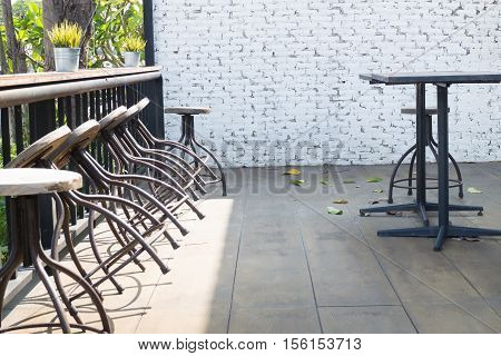 Old wooden outdoor chair on the floor stock photo