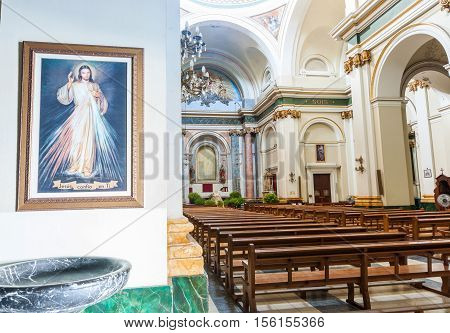 Interior Saint Maria church Xalo typically historic Mediterranean design and style Spain with picture of Jesus