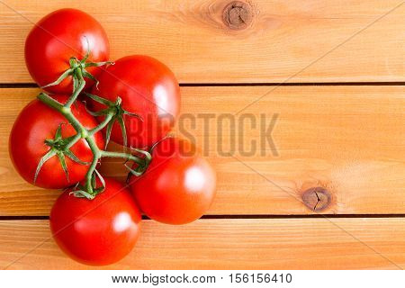 Five Hydroponic Tomatoes Over Plain Wooden Table