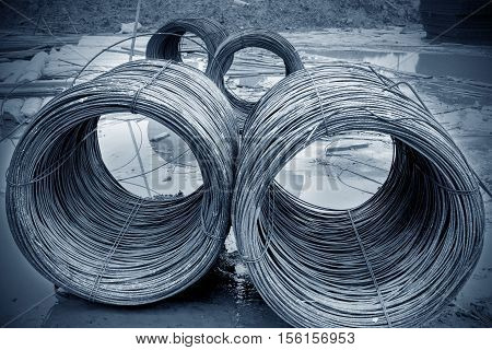 Steel rods or bars used to reinforce concrete for construction