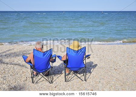 elderly couple on vacation at the beach