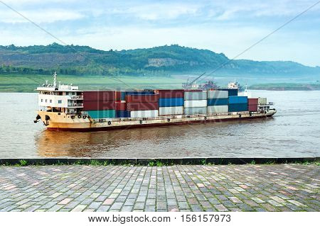 China Yangtze morning barge and container transport.
