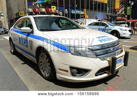 NEW YORK CITY - MAY 26, 2014: NYPD Ford Fusion Hybrid Police Car on Times Square in Manhattan, New York City, USA.
