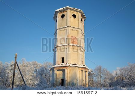 The old thrown water tower in the frosty January afternoon. Gatchina, Russia poster
