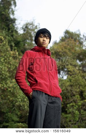Confident asian man outdoors in red