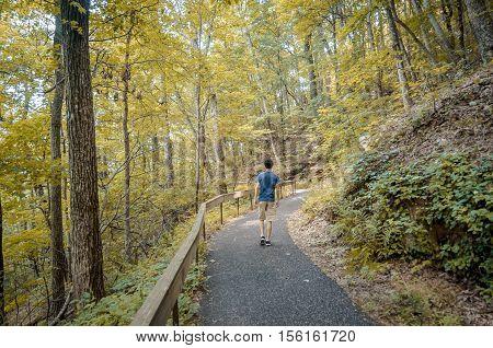 Teenager hiking the Appalachian trail during fall season