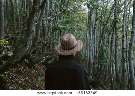 Man Wearing Hat Gloves Looking Away. Travel Cocept