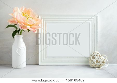White landscape frame mockup with a peony & heart beside the frame overlay your quote promotion headline or design great for small businesses lifestyle bloggers and social media campaigns