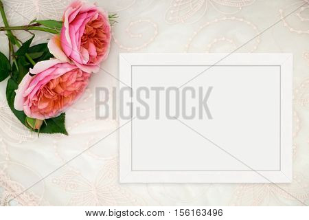 White flat lay landscape frame mockup on lace roses beside the frame overlay your quote promotion headline or design great for small businesses lifestyle bloggers and social media campaigns