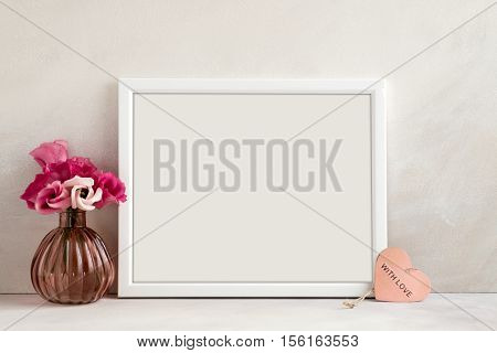White landscape frame mockup vase of flowers & a pink heart beside the frame overlay your quote promotion headline or design great for small businesses lifestyle bloggers and social media campaigns
