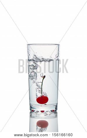 View of fresh cherry fruit with water splash with light shadow. Image is isolated on white and the file includes a clipping path.