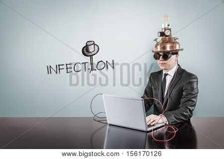 Infection text with vintage businessman using laptop at office