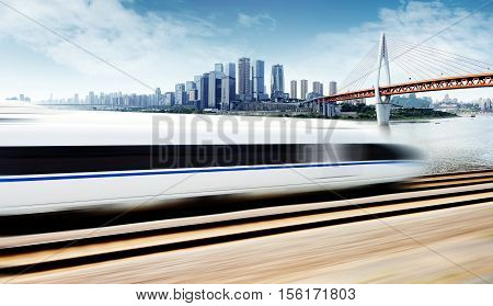 High-speed train through the Chongqing financial district of modern buildings and bridges