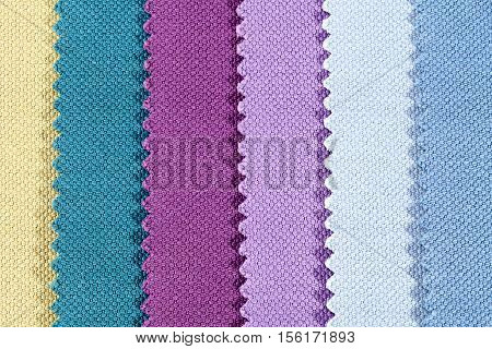 Background of colorful stripes of serrated cotton fabric close up