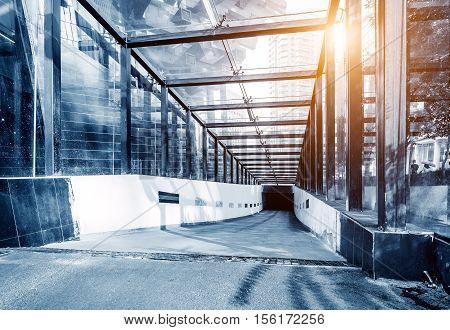Entrance ramp to underground parking garage.Blue hue map.