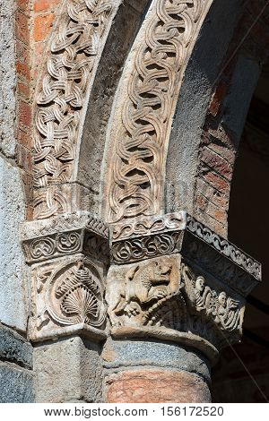 Detail of a capital with column of the famous and ancient basilica of Saint Ambrose (Sant'Ambrogio 379-1099) in Milano Lombardia Italy