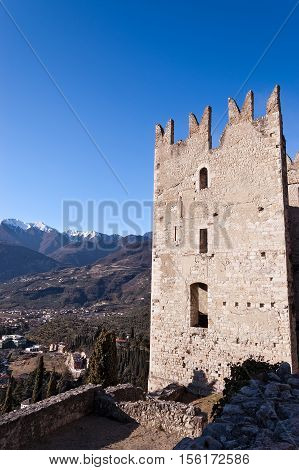 Ancient ruins of the castle of Arco di Trento (year 1000) in Trentino Alto Adige and italian Alps with snow Italy Europe