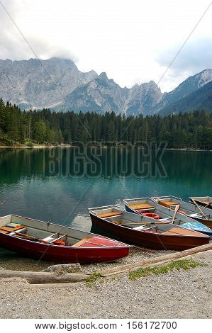 Rowboats in the Fusine Lake (Lago di Fusine). Small mountain lake in Julian Alps Tarvisio Friuli Venezia Giulia Italy