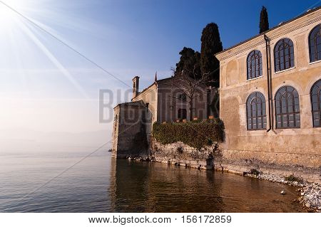 Small church Punta San Vigilio small promontory in the Garda Lake (Lago di Garda) Verona Veneto Italy Europe