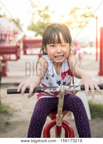 Happy Asian Baby Child Playing On Playground, Wink Action,  Sunset Light, Wink Action