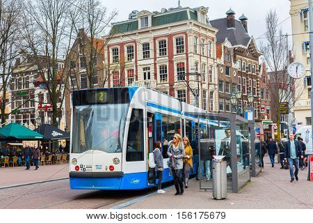 Amsterdam, Netherlands - March 31, 2016: Tram 2 running in city centre of Amsterdam, Holland