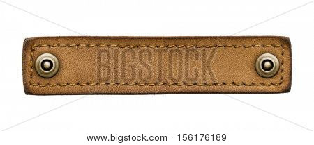 Blank leather jeans label. Isolated long tag with rivets.
