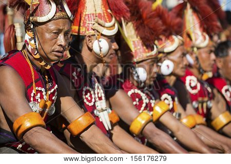 KOHIMA, NAGALAND/INDIA - DECEMBER 4, 2013: Tribes of Nagaland perform their traditional tribal dance at the annual Hornbill festival. The Hornbill is also known as the Festival of Festivals'.