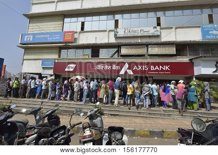 Mumbai, India - November 12, 2016: People standing in long queue to withdraw money from Axis bank