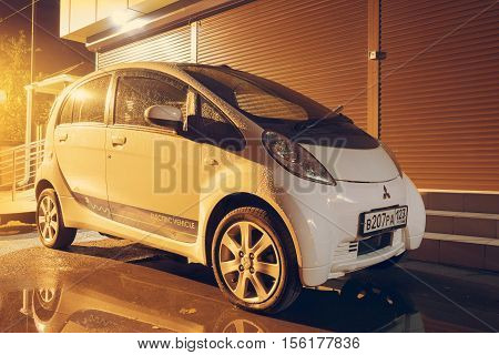 Sochi, Russia - October 09, 2016: Mitsubishi i MiEV parked on the street at night. Mitsubishi innovative Electric Vehicle.