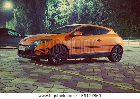 Sochi, Russia - October 09, 2016: Beautiful sportcar (Renault Megan Sport Edition) parked on the street of Sochi at night.