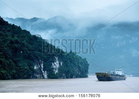 China Three Gorges heavy rain and large barges.