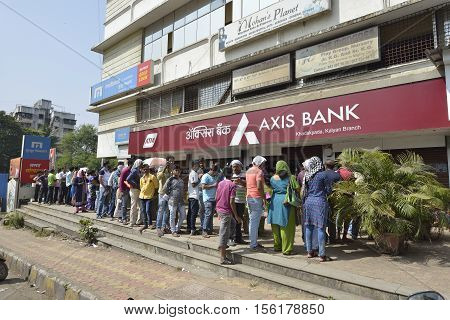 Mumbai, India - November 12, 2016: People standing in long queue to withdraw money from banks