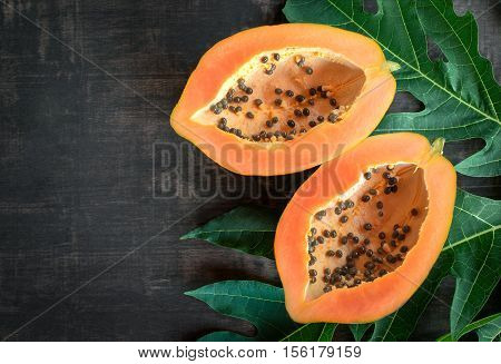 Ripe Papaya On Wood Table From Above , Ripe Papaya Health Benefits.
